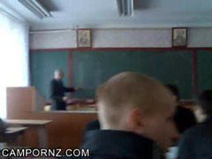 Amateur teen girl gives handjob in classroom