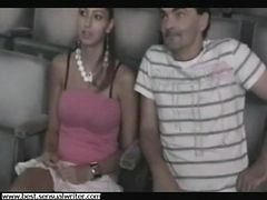 girl jerks 2 guys in a porn cinema