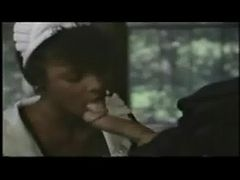 Ron Jeremy gets a blowjob from a black maid