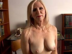 Mature Lady Strips Slowly