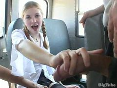 tow schools girls in a bus with a teacher