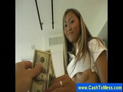 Asian masseuse gives a handjob for cash